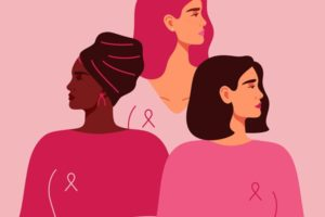 Three women with pink ribbons of different nationalities standing together. Breast cancer